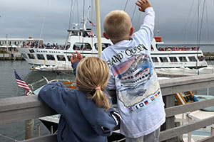 kids waving to ferry